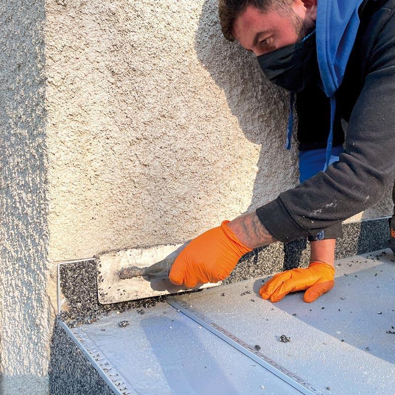 Application verticale des granulats de marbre et résine par Bélaribi Résine